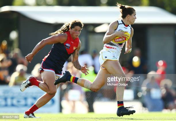 Chelsea Randall of the Crows runs with the ball from Richelle Cranston of the Demons during the round two AFLW match between the Melbourne Demons and...
