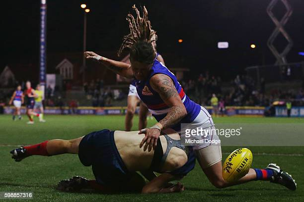 Chelsea Randall of the Demons gets her jumper ripped off in a tackle during the AFL Women's Exhibition Match between the Western Bulldogs and the...