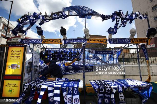 Chelsea scarves and flags blow in the strong winds ahead of the Premier League match between Chelsea FC and Wolverhampton Wanderers at Stamford...