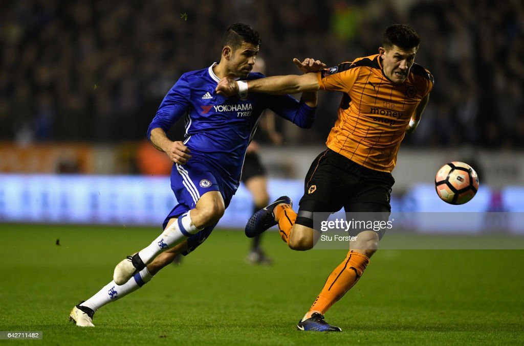 Chelsea striker Diego Costa (l) and Wolves player Danny Batth in action during The Emirates FA Cup Fifth Round match between Wolverhampton Wanderers and Chelsea at Molineux on February 18, 2017 in Wolverhampton, England.