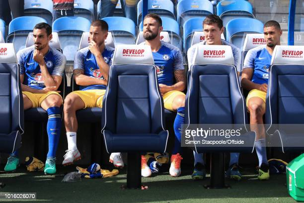 Chelsea substitutes LR Davide Zappacosta Eden Hazard Olivier Giroud Andreas Christensen and Ruben LoftusCheek sit on the bench ahead of the Premier...