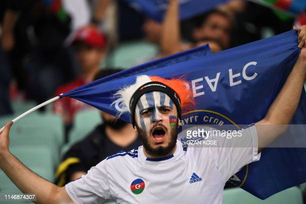 A Chelsea supporter cheers prior to the UEFA Europa League final football match between Chelsea FC and Arsenal FC at the Baku Olympic Stadium in Baku...