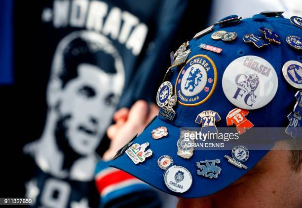 A Chelsea supporter wears a cap covered in Chelsea badges in the build up to the English FA Cup fourth round football match between Chelsea and...