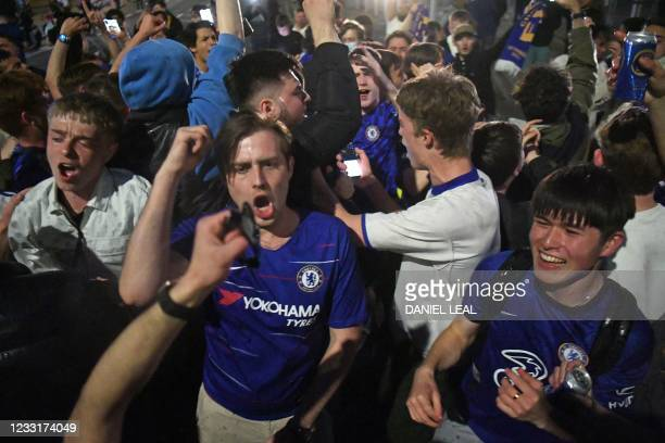Chelsea supporters celebrate in streets surrounding Chelsea's Stamford Bridge stadium in London, after Chelsea beat Manchester City to win the UEFA...