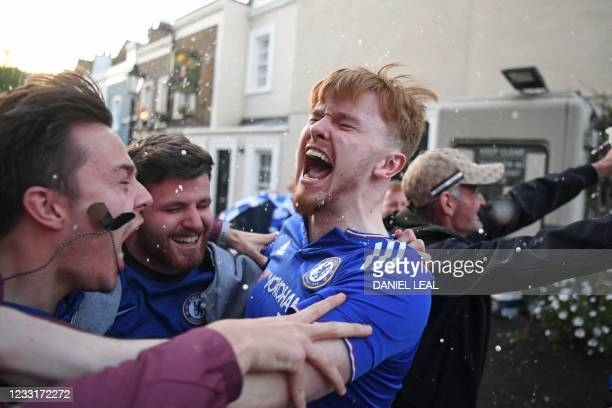 Chelsea supporters celebrate in the streets around Stamford Bridge, after Chelsea take the lead over Manchester City in the UEFA Champions League...