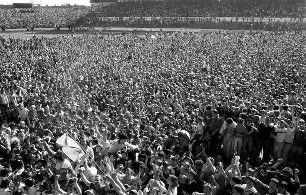 Chelsea supporters flood the pitch in celebration after the final whistle to acclaim the team's promotion to the First Division after the English...