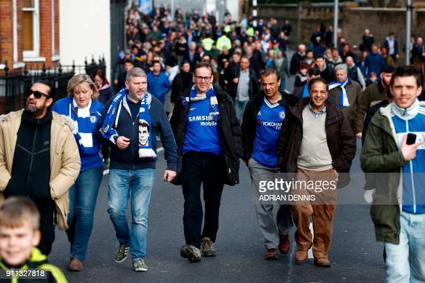Chelsea supporters walk to the ground for the English FA Cup fourth round football match between Chelsea and Newcastle United at Stamford Bridge in...