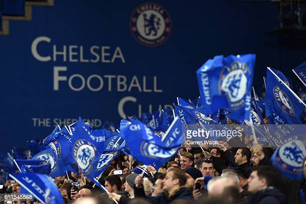 Chelsea supporters wave their club flags in support