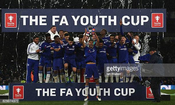 Chelsea team celebrates with the trophy after winning the FA Youth Cup Final Second Leg match between Chelsea v Manchester City at Stamford Bridge on...