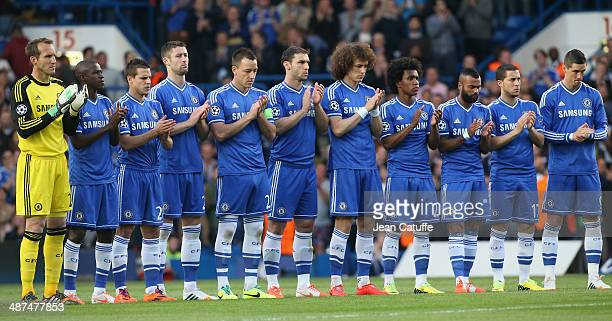 Chelsea team line up to observe a silence in memory of former FC Barcelona coach Tito Vilanova and former Real Madrid coach Vujadin Boskov prior to...