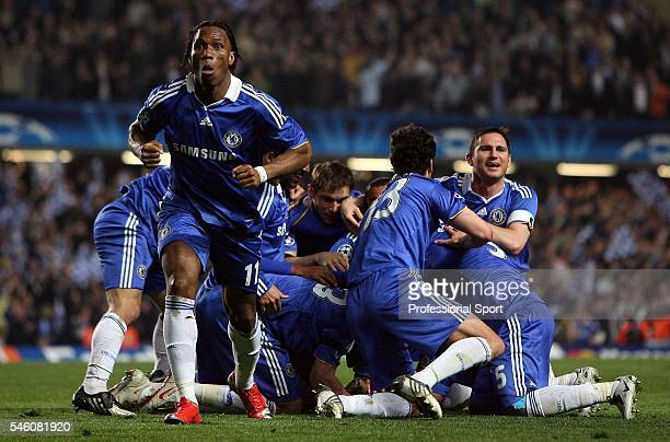 Chelsea teammates celebrate a goal scored by Alex during the UEFA Champions League Quarterfinal 2nd leg match between Chelsea and Liverpool at...