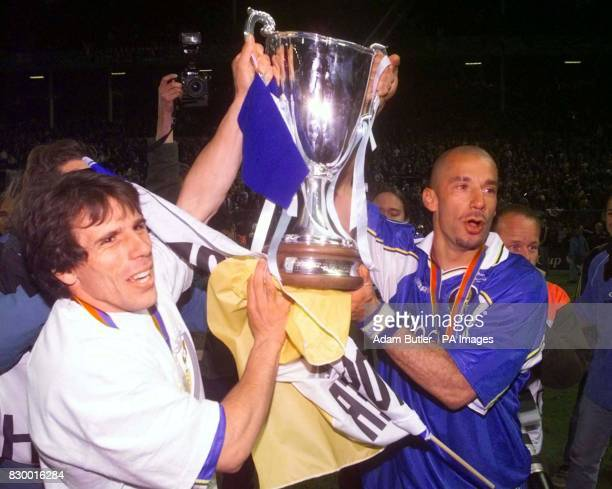 Chelsea teammates Gianfranco Zola, left and Gianluca Vialli hold up the Cup Winner's cup after winning the match against VfB Stuttgart tonight ....