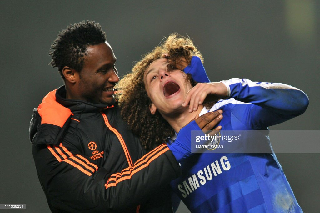 Chelsea teammates John Obi Mikel and David Luiz celebrate following their team's victory during the UEFA Champions League round of 16 second leg match between Chelsea FC and SSC Napoli Stamford Bridge on March 14, 2012 in London, England.