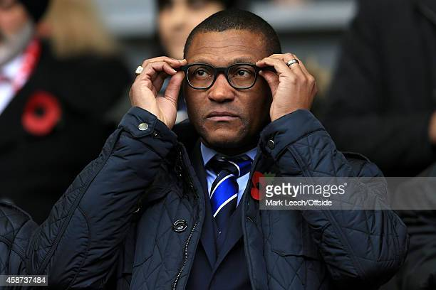 Chelsea Technical Director Michael Emenalo adjusts his glasses during the Barclays Premier League match between Liverpool and Chelsea at Anfield on...