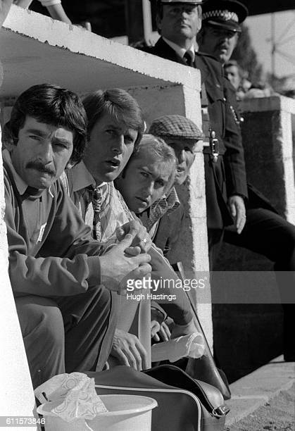 Chelsea trainer Norman Medhurst Manager Geoff Hurst Clive Walker and a member of the Chelsea ground staff in the Chelsea dugout