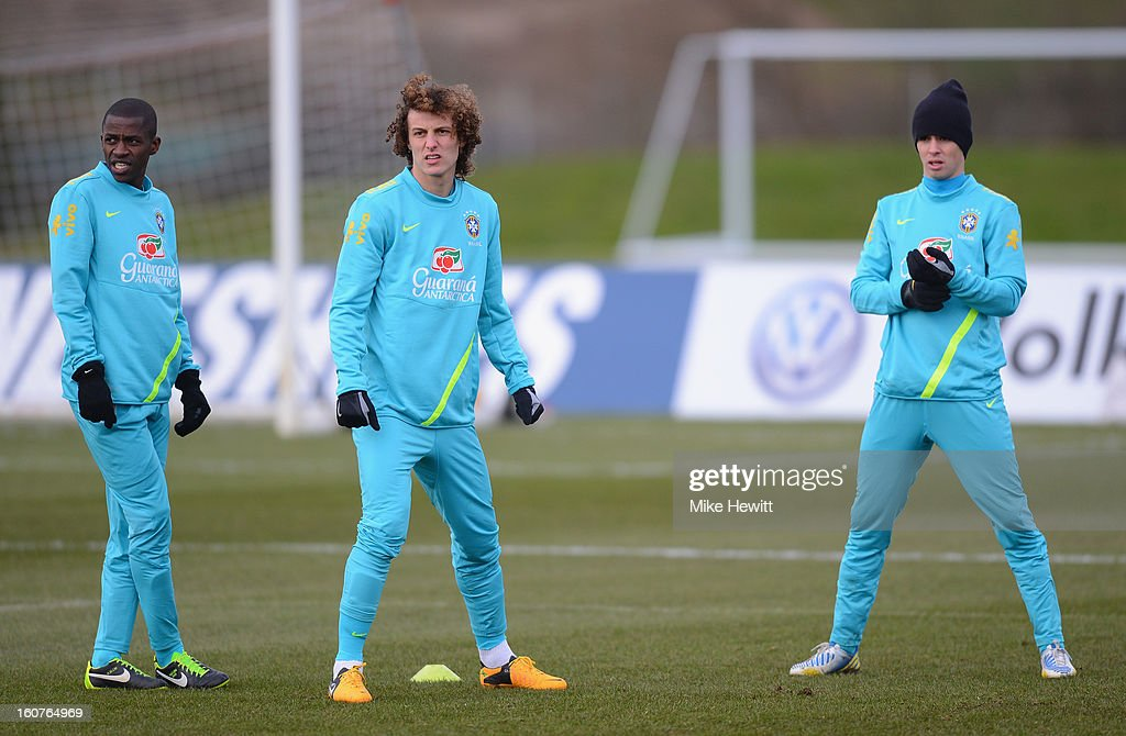 Chelsea trio Ramires, David Luiz and Oscar of Brazil look on during a Brazil training session at The Hive football centre on February 5, 2013 in London, England.