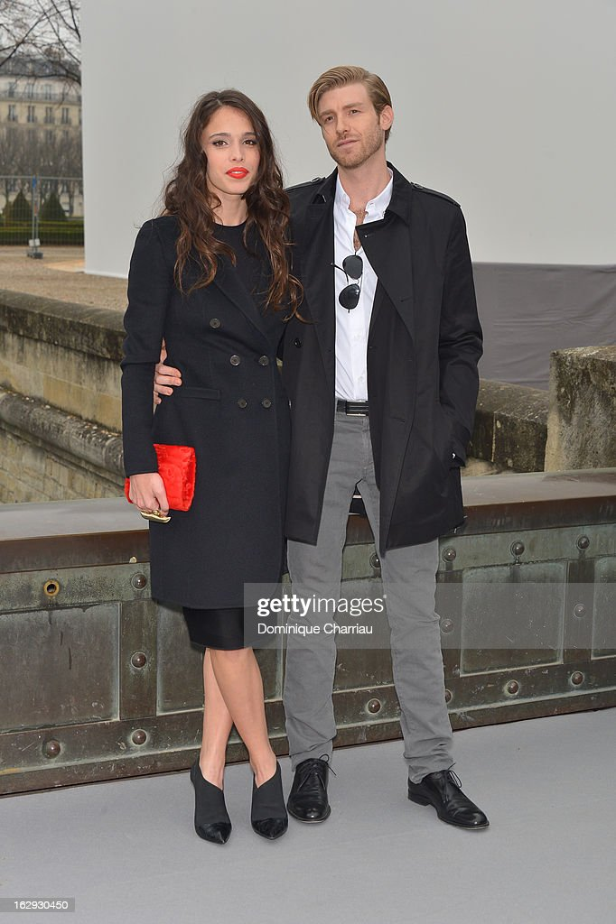 Chelsea Tyler (L) and companion Joe Foster pose as they arrive at the Christian Dior Fall/Winter 2013 Ready-to-Wear show as part of Paris Fashion Week on March 1, 2013 in Paris, France.
