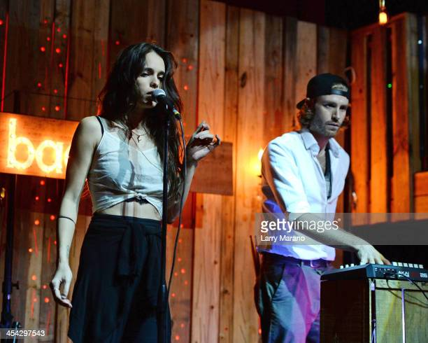 Chelsea Tyler and Jon Foster of Badbad perform at Stache on December 7 2013 in Fort Lauderdale Florida