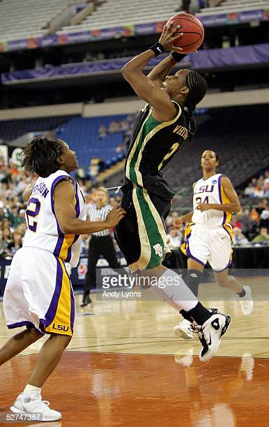 Chelsea Whitaker of the Baylor Lady Bears shoots over Temeka Johnson of the Louisiana State Lady Tigers in the Semifinal game of the Women's NCAA...