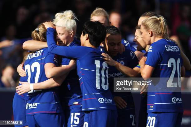 Chelsea Women's players celebrate with goalscorer Bethany England during the SSE Women's FA Cup Fifth Round match between Chelsea Women and Arsenal...