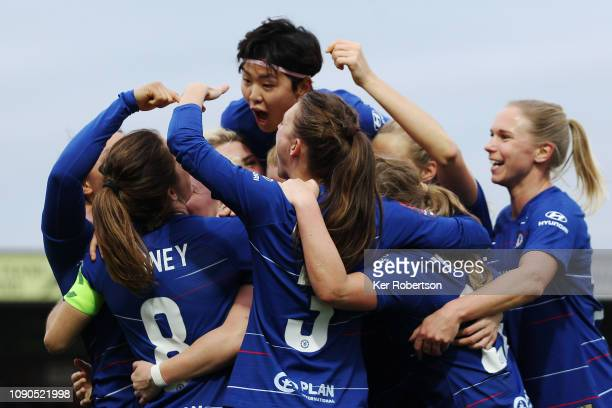 Chelsea Women's team celebrate with goalscorer Drew Spence as she scores her sides second goal during the FA Women's Super League match between...