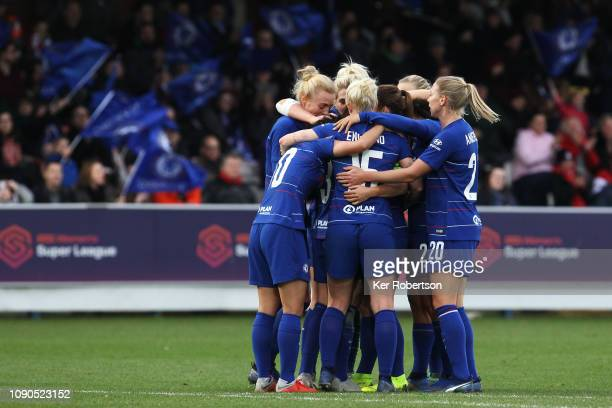 Chelsea Women's team celebrate with goalscorer Hannah Blundell as she scores her sides second goal during the FA Women's Super League match between...