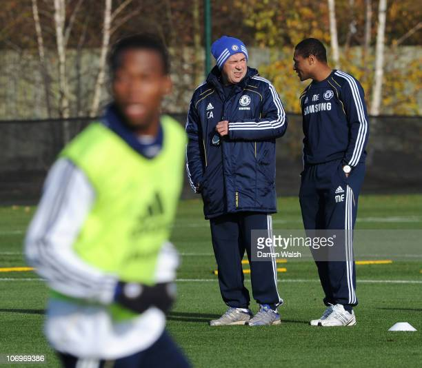 Chelsea's 1st team coach Carlo Ancelotti talks to 1st team assistant coach Michael Emenalo during a training session at the Cobham training ground on...