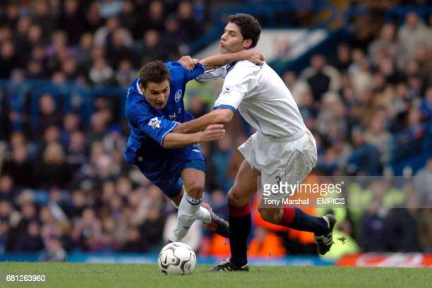 Chelsea's Adrian Mutu clashes with Portsmouth's Dejan Stefanovic