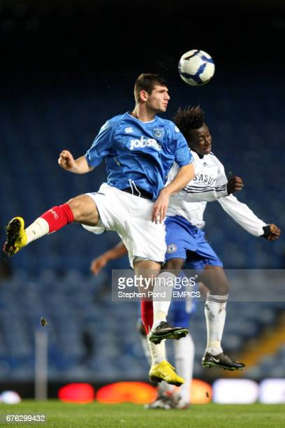 Chelsea's Aliu Djalo and Portsmouth's Nadir Ciftci battle for the ball in the air
