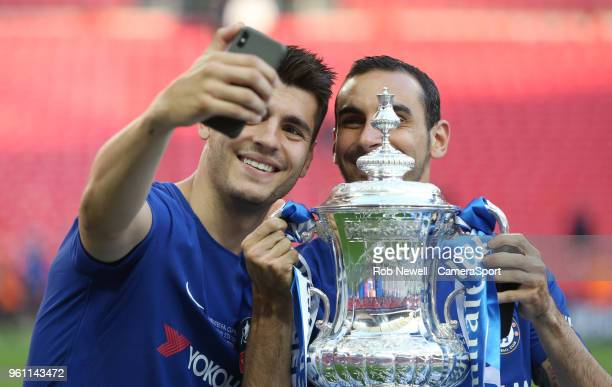 Chelsea's Alvaro Morata and Davide Zappacosta take a selfie with the cup during the Emirates FA Cup Final match between Chelsea and Manchester United...