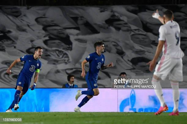 Chelsea's American midfielder Christian Pulisic celebrates scoring the opening goal during the UEFA Champions League semi-final first leg football...