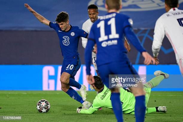 Chelsea's American midfielder Christian Pulisic scores during the UEFA Champions League semi-final first leg football match between Real Madrid and...