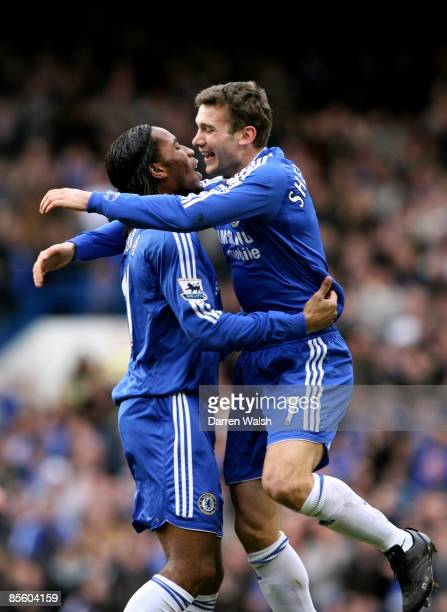 Chelsea's Andriy Shevchenko celebrates scoring the opening goal of the game with Didier Drogba
