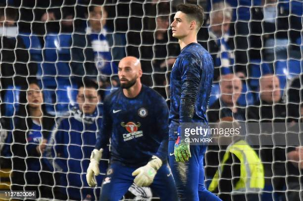 Chelsea's Argentinian goalkeeper Willy Caballero and Chelsea's Spanish goalkeeper Kepa Arrizabalaga warm up ahead of the English Premier League...