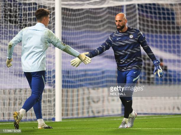 Chelsea's Argentinian goalkeeper Willy Caballero and Chelsea's Spanish goalkeeper Kepa Arrizabalaga warm up prior to the English League Cup third...