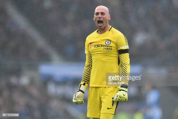 Chelsea's Argentinian goalkeeper Willy Caballero celebrates after Chelsea's Brazilian midfielder Willian scores their second goal during the English...