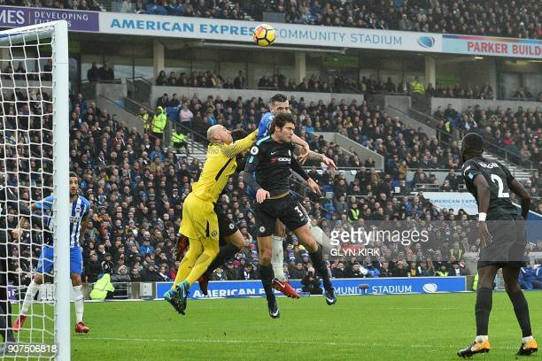 Chelsea's Argentinian goalkeeper Willy Caballero jumps for the ball by Brighton Irish defender Shane Duffy and Chelsea's Spanish defender Marcos...