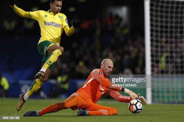 Chelsea's Argentinian goalkeeper Willy Caballero saves during the FA Cup third round replay football match between Chelsea and Norwich City at...