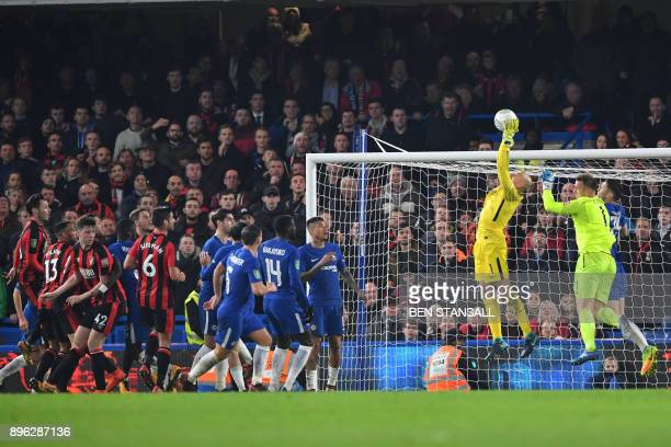 Chelsea's Argentinian goalkeeper Willy Caballero saves from a corner during the English League Cup quarterfinal football match between Chelsea and...