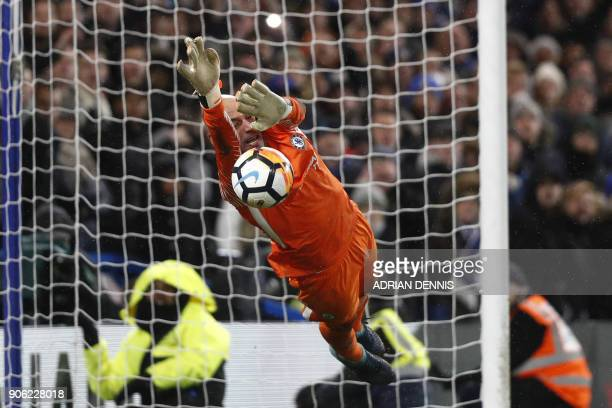 Chelsea's Argentinian goalkeeper Willy Caballero saves the penalty from Norwich City's Portuguese striker Nelson Oliveira during the FA Cup third...