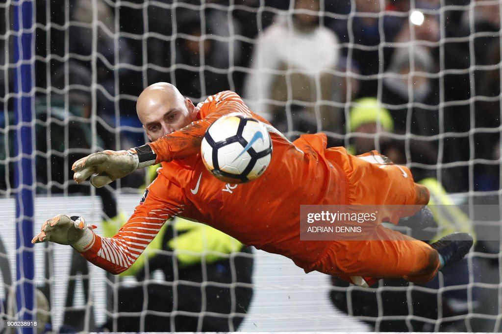 TOPSHOT - Chelsea's Argentinian goalkeeper Willy Caballero saves the penalty from Norwich City's Portuguese striker Nelson Oliveira during the FA Cup third round replay football match between Chelsea and Norwich City at Stamford Bridge in London on January 17, 2018. / AFP PHOTO / Adrian DENNIS / RESTRICTED TO EDITORIAL USE. No use with unauthorized audio, video, data, fixture lists, club/league logos or 'live' services. Online in-match use limited to 75 images, no video emulation. No use in betting, games or single club/league/player publications. /