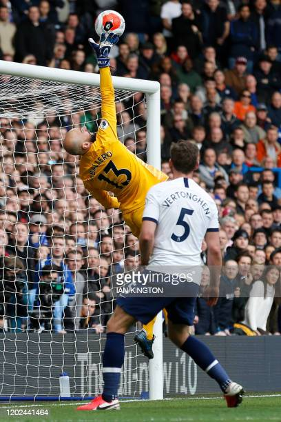 Chelsea's Argentinian goalkeeper Willy Caballero tips the ball over the post during the English Premier League football match between Chelsea and...