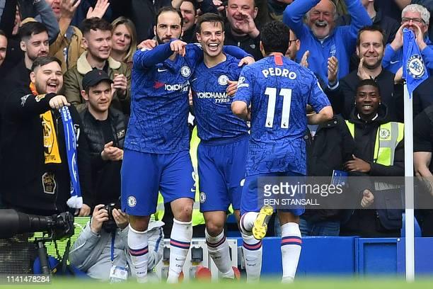 Chelsea's Argentinian striker Gonzalo Higuain celebrates scoring his team's third goal with Chelsea's Spanish defender Cesar Azpilicueta and...