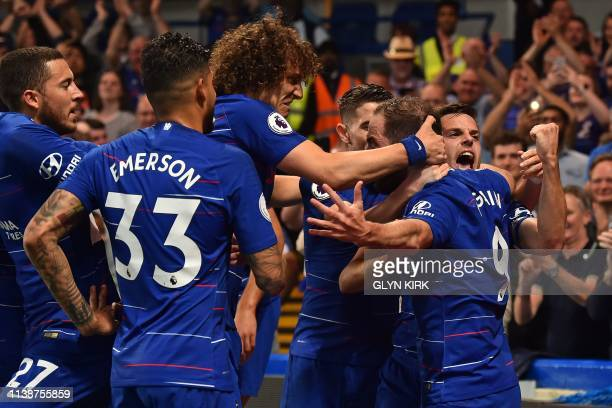 TOPSHOT Chelsea's Argentinian striker Gonzalo Higuain celebrates with teammates after scoring their second goal during the English Premier League...