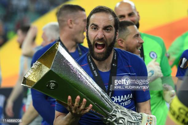 TOPSHOT Chelsea's Argentinian striker Gonzalo Higuain celebrates with the trophy after winning the UEFA Europa League final football match between...