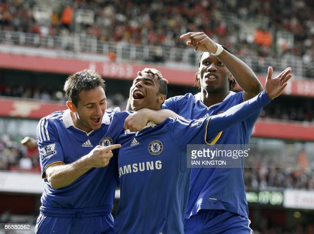 Chelsea's Ashley Cole Chelsea's Frank Lampard and Chelsea's Ivory Coast footballer Didier Drogba celebrates the own goal by Arsenal's Ivory Coast...