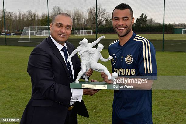 Chelsea's Ashley Cole receives an award for his 100 England appearances from PFA's Bobby Barnes after a training session at the Cobham Training...