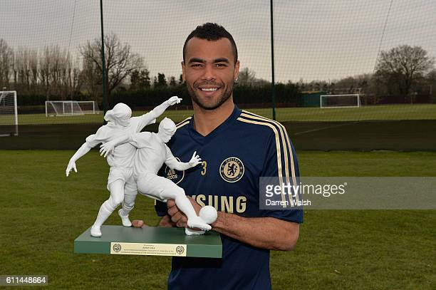 Chelsea's Ashley Cole receives an award for his 100 England appearances from the PFA's after a training session at the Cobham Training Ground on 5th...