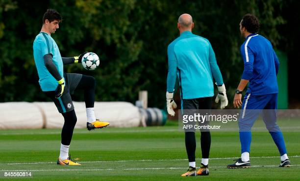 Chelsea's Belgian goalkeeper Thibaut Courtois and Chelsea's Argentinian goalkeeper Willy Caballero attend a team training session at Chelsea's Cobham...