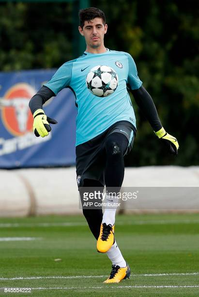 Chelsea's Belgian goalkeeper Thibaut Courtois attends a team training session at Chelsea's Cobham training facility in Stoke D'Abernon southwest of...